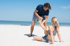 Trainer helping runner stock photo