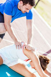 Trainer helping during strech out Stock Image