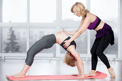 Trainer helping student to do exercise bridge Royalty Free Stock Images