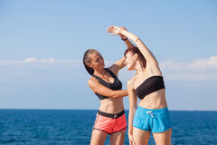 Trainer helps the girl to do the exercises royalty free stock image
