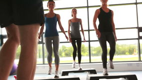 Trainer with his female aerobic group stock video footage