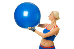 Trainer holding a fitness ball Stock Images