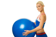trainer holding a fitness ball Royalty Free Stock Images