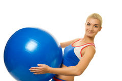trainer holding a fitness ball Stock Photography
