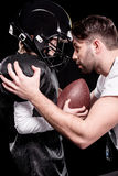 Trainer instructing boy american football player Stock Photography
