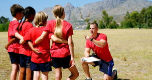 Trainer instructing kids in the boot camp stock footage