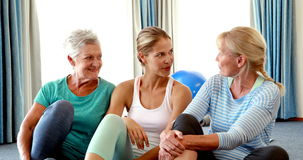 Trainer interacting with senior women during break stock footage