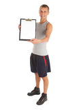Trainer keeping blank clipboard Stock Photography