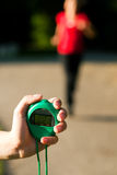 Trainer measuring time of runner Stock Photo
