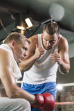 Trainer motivating boxer. Boxing club- young trainer motivating boxer before fight Royalty Free Stock Photos