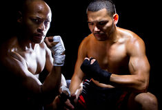 Trainer Motivating Fighter. Trainer motivating a muscular Boxer or MMA fighter with pep talks Stock Images