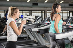 Trainer motivating woman. Trainer motivating women at the gym Stock Photos