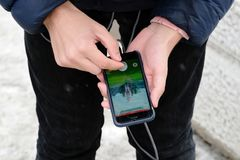 Trainer Pokemon Go catches the legendary Pokemon MewTwo stock image