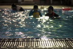 Trainer practive child to swim. Blurred abstract. Blurred abstract concept of trainer practive child boy to swim in pool. Selective focus swimming pool edge stock photos
