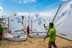 Trainer preparing Optimist class boat Stock Image