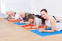 Trainer and senior customers at gym Royalty Free Stock Images