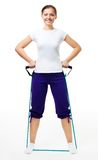 Trainer show exercise with expander Royalty Free Stock Photography