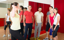 Trainer showing dancing moves to group Stock Photo