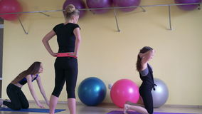Trainer showing exercises to girls. 4k stock footage