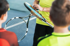 Trainer showing sports equipment to kids Royalty Free Stock Photo