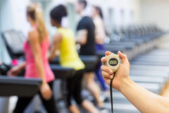 Trainer showing the stop watch Stock Photography