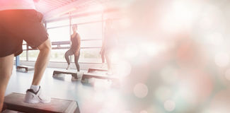 Trainer stepping with aerobics class. In gym Royalty Free Stock Photography