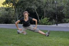 Trainer stretching in forest nature Royalty Free Stock Images
