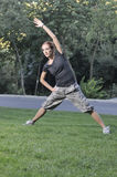 Trainer stretching in forest nature Stock Photography