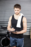 Trainer taking notes at crossfit gym Royalty Free Stock Photos