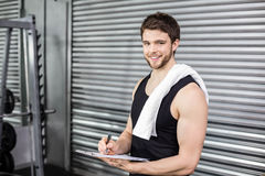 Trainer taking notes at crossfit gym Royalty Free Stock Images