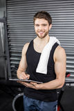 Trainer taking notes at crossfit gym Stock Photo