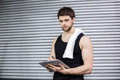 Trainer taking notes at crossfit gym Royalty Free Stock Photo