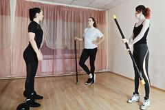 Trainer talking with group. Of women in gym. Horizontal shot Stock Photos