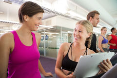Trainer talking to her client on the treadmill Stock Photography