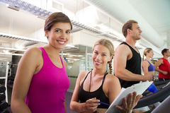 Trainer talking to her client on the treadmill Stock Photos