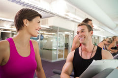 Trainer talking to his client on the treadmill Stock Photography