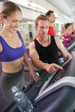 Trainer talking to his client on the treadmill Royalty Free Stock Photography