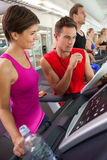 Trainer talking to his client on the treadmill Royalty Free Stock Images