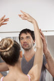 Trainer Teaching Ballet To Ballerina In Studio Royalty Free Stock Photo