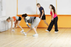 Trainer teaching group to make exercise Royalty Free Stock Images