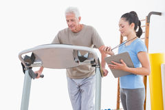 Trainer timing senior man Stock Image