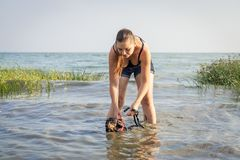 The trainer training with the dachshund dog teaches swimming. A useful exercise for back health in dogs.  stock photography