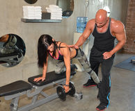 Trainer Training. Trainer helps client train with weights. Couple training together Stock Photos