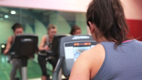 Trainer training with her spinning class stock video footage