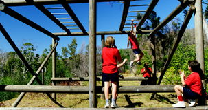Trainer training kids in the boot camp stock footage
