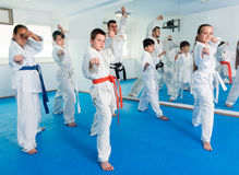 Trainer is training teenagers. In karate class Stock Image