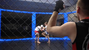 Trainer watchs to sparring of little boys. Trainer watchs to sparring of little warriors stock footage