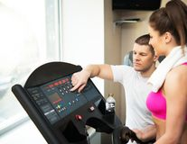 Trainer and woman in fitness club royalty free stock images