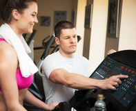Trainer and woman in fitness club Stock Images