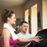 Trainer and woman in fitness club Stock Image
